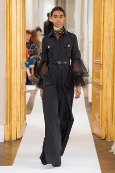 <p>Jumpsuit in onyx silk faille and blouse in black silk gauze embroidered with jet.</p><p></p>