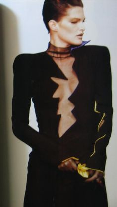 Thierry Mugler, 80s dress with zigzag lightning bolt cutout down the bodice.