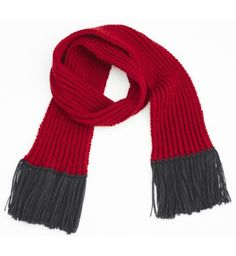 The North Circular Tomlin Scarf is hand-knitted with love in the UK by a team of 'Grannies' and models using the finest British wool.