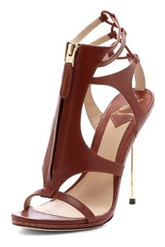 Gorgeous shoes. The chocolate leather and the golden stiletto make this pair of heels super sexy. #fashion #women
