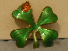 A David Andersen brooch in the form of a lucky ladybird and four-leaf clover.