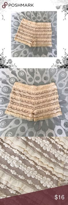 """NWOT Love Spray Bloomer Style Shorts Tag says M, but in my opinion, these fit like a Small. Waist across measures approx 13"""", laid flat. Waistband is elasticized. Front Rise is approx 8"""". Inseam is approx 2"""". Tiered ruffle and floral crotchet Lace detail throughout. 36% Cotton/62% Acrylic/2% Spandex. Lined. Bundle for discounts! Thank you for shopping my closet! Bin 35 Love Spray Shorts"""