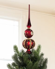 Be captivated by the spellbinding allure of Balsam Hill's exclusive Burgundy And Gold Tree Topper.