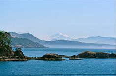 San Juan Islands, north of Washington State. My idea is this: I want to be able to ride a bike, walk, camp -maybe in one of those small drive -it-sleep-in-it vehicles, and ride many ferries between and across the islands.  Lots of berries, ferns and pockets full of rocks.  http://www.visitsanjuans.com/