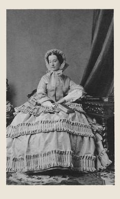 1858 Empress Eugenie in a traveling ensemble. Notice the varying widths of self trim.