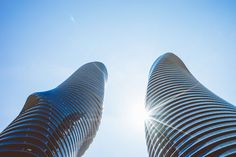 #architecture #buildings #curves #glass #high rises #low angle shot #perspective #skyscraper #sun glare
