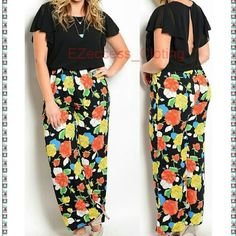 "New sexy women plus size jumpsuit catsuit black Listing is for black one. Blue is not  available. Sexy  plus size floral print black multi colored Romper jumpsuit catsuit. Black top with Vibrant Floral print leg flared bottom. pants  Very sexy. Bust 1X :45"" and 2X: 48"" Indeam 33"" A MUST HAVE. Boutique  Pants Jumpsuits & Rompers"