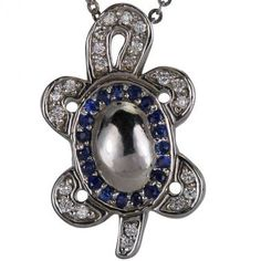 This uniquely designed turtle pendant has a combined total of 0.30ct of blue sapphires and bright white diamonds.