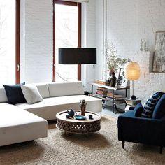 white walls, pools of light, brick textures
