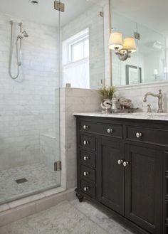 I like this - shower in corner and half wall between vanity area under window - basement bathroom