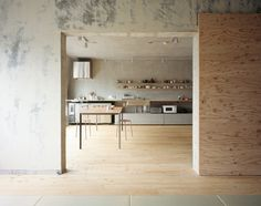 Add Some Warmth: 12 Plywood Interiors \\\ Photo by Masao Nishikawa. Concrete and pale plywood mingle to perfection in the Setagaya Flat in Tokyo, designed by Narus Inokuma Architects and Hiroko Karibe Architects. It's their own home. We wish it were ours.