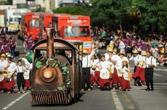 grape festival parade celebrating the italian immigration and their winemaking abilities in caxias do sul, by O Caxiense