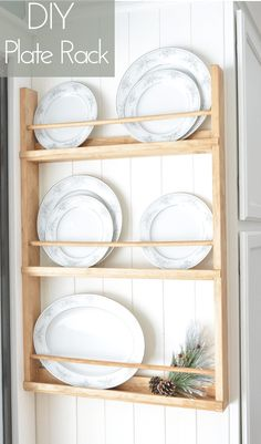 plate racks Build a DIY wall plate rack with these free plans. This post may contain affiliate links. If you make a purchase from one of the links, I may make a small commission at NO EXTR Wooden Plate Rack, Plate Rack Wall, Diy Plate Rack, Wooden Plates, Plates On Wall, Plate Wall Decor, Diy Kitchen Projects, Diy Projects, Pallet Projects