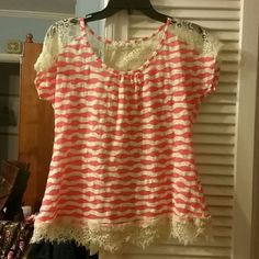 Orange and white top with lace back Orange and white stripes. Short sleeves very light weight. Lace at bottom of shirt, on shoulders, and down spine. Bow on back between shpulders. 60% cotton and 40% polyester. 24 inches long. a'reve Tops Blouses