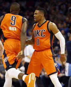 Oklahoma City's Russell Westbrook (0) congratulates Serge Ibaka (9) on a score during the NBA basketball game between the Oklahoma City Thunder and the Denver Nuggets at Chesapeake Energy Arena on Dec. 27, 2015 in Oklahoma City, Okla. Photo by Steve Sisney, The Oklahoman
