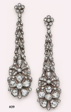 Magnificent, eighteenth century-cut diamond, silver and gold drop earrings. These impressive and rare earrings were made in the Napoleonic era in France. The diamonds are set in silver with backings of 18kt yellow gold.