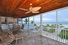 Step off the screened lanai of this wonderful four bedroom, four bath home and experience true beach living.
