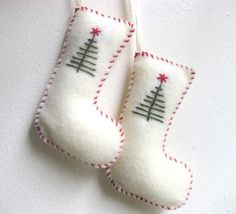 This is a pair of unique handmade felt ornaments - Christmas stockings! They are white with dark green and dark red decorative stitching. Each