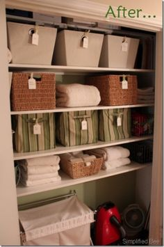 I love those label tags.  You would always know the contents and you could switch out items over time.  But why use 4 different styles? I'd find one and use it exclusively. See the small container on the bottom shelf? I wonder what's inside? Is it related to those towels? If not I'd move the towel on the second shelf down.  All the towels would be together and all the rattan containers would be on one shelf.  Symmetry is visually relaxing.