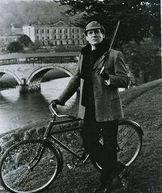 Jeremy Brett as Sherlock Holmes with his bike.