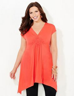 Discover perfectly versatile pieces from our AnyWear Collection that mix, match and pack beautifully, wherever life takes you. Our soft, stretch tank has street style that proves you can mix and match colors. Embroidered medallion at the bust cinches for a flattering fit. Pairs perfectly with our layerable Harmony Layering Cascade for a coordinating look. V-neckline. Side slits at hem. Catherines tops are perfectly proportioned for the plus size woman. catherines.com