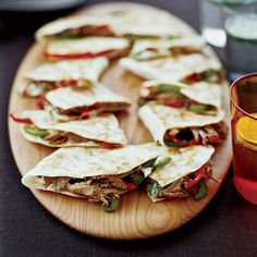 Tim Love overstuffs his quesadillas with delectable braised pork and sautéed onions and peppers, then goes (almost) over the top by smearing the tort...