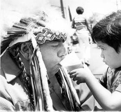 Chief Little Bear of the Fernandeño Tataviam tribe receives a helping hand from his grandson, circa 1990s. San Fernando Valley History Digital Library.