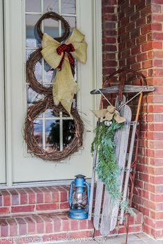 Christmas Porch Decorating Ideas old sled and grapevine wreath snowman