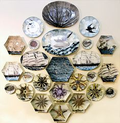 Great wall of John Derian sea-themed plates!