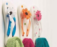 Flip flop wall hooks for the girls' beach-themed bathroom. Inexpensive, cute and easy to DIY!