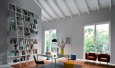Novamobili....high white ceilings, pale silver walls, wood floors, white bookcases with ladder, lots of windows.