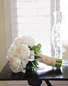 This classic bouquet of white peonies is wrapped in hemp for an earthy element.