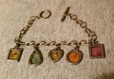 BRACELET MULTI SHAPED GLASS CHARMS WITH EMBEDDED TINY FLOWERS