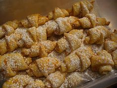 """""""Kiffle"""" Recipe: A Christmas Pastry - Kiffles seem to be a Pennsylvanian take on a traditional Hungarian pastry called """"kiflis."""" A kiffle is a triangle shaped piece of dough rolled will a fruit fillin Croatian Recipes, Dutch Recipes, Hungarian Recipes, Hungarian Food, German Recipes, Hungarian Cuisine, Amish Recipes, Paleo Recipes, Baking Recipes"""