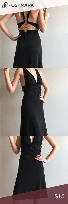 Black deep V dress from Victoria's Secret. Beautiful black dress with Gold rings on the back along with a deep neck line and intricate cinching at the waist line. Really good condition. The length comes to just above the knee ( the model is 5'7). Moda International Dresses Mini