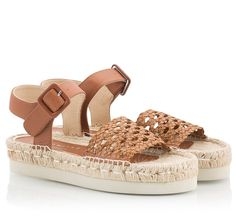 Palomitas By Paloma Barcelo AMANDA Sandals are crafted from tan vitello leather with a braided leather wide strap over toe for a playful touch. The espadrille outsole of this flatform pair is finished with a lightweight rubber sole to ensure a comfortable all-day wear.