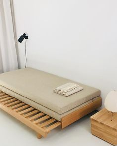 Guest Bed with a soft beige woollen fabric. From daybed to double bed. #bautier #guestbed