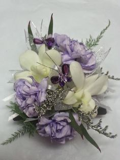 Loved it! Pinned it! A Blooming Envy Design!  Wrist Corsage with Lilac carnations, White Dendrobium Orchids, Purple Limonium, Purple Butterfly Accent