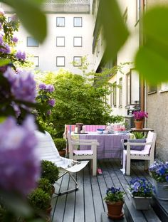 terrace with potted flowers, table & chairs