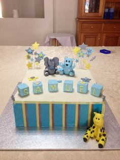 Christening baby boy caramel mud cake with white chocolate ganache and fondant. Was my first attempt to work with gumpaste to make the animals - giraffe, teddy bear and elephant..... Turned out ok-ish;)