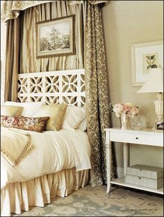 interesting headboard + neutral colors and fabrics + needlepoint pillow
