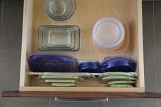 We all have one: a place where food storage containers are kept a. the Tupperware cabinet. If yours is like mine, then it's a mess of plastic food storage lids and containers that aren't nested. Organiser Tupperware, Tupperware Organizing, Tupperware Storage, Container Organization, Kitchen Organization, Organization Hacks, Kitchen Storage, Kitchen Drawers, Organized Kitchen