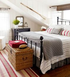 modern farmhouse. rustic cottage.  iron bed frame. black dresser. wicker  ottoman/storage chest. gray. red. white. black.