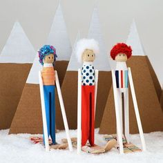 Olympic Skiing Clothespin Dolls - just think of all the different fuzzy hats and ski gear the dolls could be wearing | MollyMoo for @Spoonful #winterolympics #olympicscrafts #skiingcraft