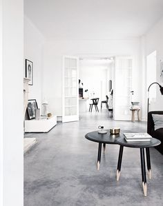 I love white. All kind of white and all hues of white. And I love concrete. And of course, I love their...