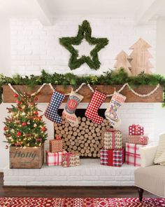A wreath in the shape of a star, bright and cheery presents, and country-style stockings create the perfect Christmas scene for a festive mantel.