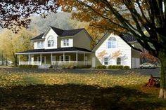 Farmhouse Exterior - Front Elevation Plan #1-765 - Houseplans.com