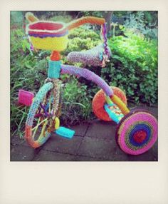 Tricycle for when the baby gets a bit older, plus its yarn bombed like the baby's owl hat is crocheted.