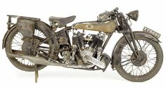dusty old  1925 Brough SS80 looks a bit so saggy to get tossed in with the racers. So he'll grumpily sit here instead