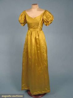 """Yellow silk satin gown, English, c. 1810. Augusta Auctions: """"Wide V neckline, short puff sleeves, padded skirt hem, inset waistband, linen bodice & sleeve linings, B 32"""", W 24"""", L 53"""", (hooks & eyes moved & replaced w/ modern)"""